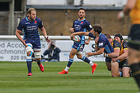 Joe Luca Smith of London Scottish is tackled during the Greene King IPA Championship match between London Scottish Football Club and Ealing Trailfinders at Richmond Athletic Ground, Richmond, United Kingdom on 8 September 2018. Photo by David Horn.