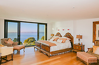 BNPS.co.uk (01202 558833)<br /> Pic: KnightFrank/BNPS<br /> <br /> A luxury seaside home that has gone on the market for £3m is a turn off for any Labour voter - as it looks out on to Thatcher's Rock.<br /> <br /> The modern and contemporary property is in one of the most exclusive areas of Torquay in Devon and has spectacular views of Tor Bay.<br /> <br /> In the foreground in the rocky outcrop known as Thatcher's Rock.<br /> <br /> But the coastal landmark isn't named after the late Tory Prime Minister but the fact that from certain angles the rock formation looks like a thatcher working on a roof.