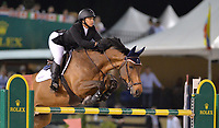WELLINGTON, FL - MARCH 14: Paige Johnson participants in the $127,000 Horseware Ireland Grand Prix at the Winter Equestrian Festival at Palm Beach International Equestrian Center on March 14, 2015 in Wellington, Florida.<br /> <br /> <br /> People:  Paige Johnson