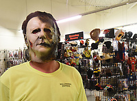 """David Henderson, a manager at Halloween Express at Frisco Station Mall in Rogers, models on Wednesday Oct. 6 2021 a Michael Myers mask from the movie, """"Halloween."""" Go to nwaonlinecom/211010Daily/ to see more photos.<br />(NWA Democrat-Gazette/Flip Putthoff)"""
