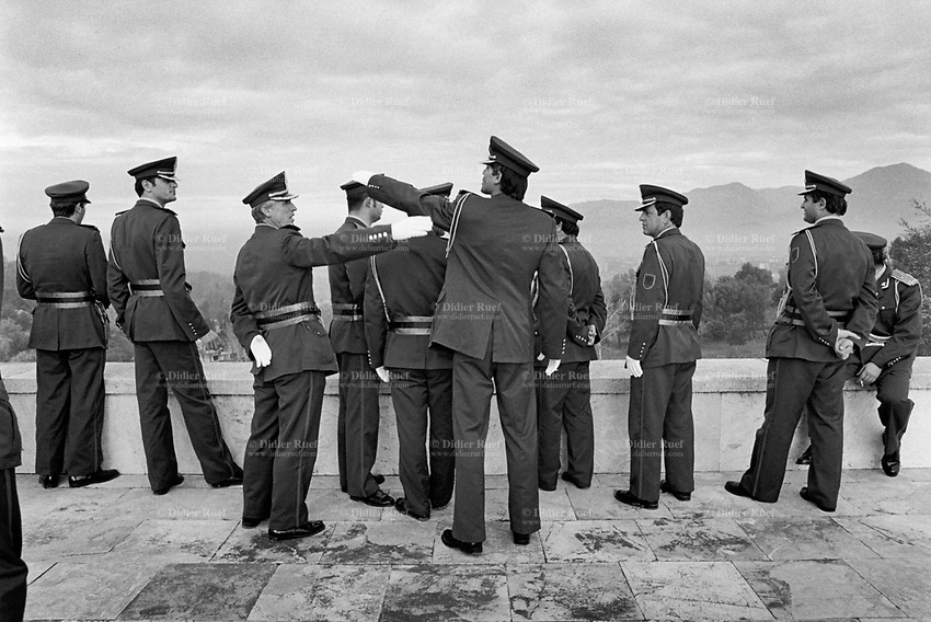 Albania. Tirana. National Martyrs Cemetery. The Orchestra Frymore is the only Albanian military brass band. The band isrelaxing after having payed on National Day at the National Martyrs Cemetery of Albania which is the largest cemetery in Albania, located on a hill overlooking Tirana. A military band is a group of personnel that performs musical duties for military functions or official events. A typical military band consists mostly of wind and percussion instruments. Tirana is the capital and largest city of Republic of Albania. 29.11.1998 © 1998 Didier Ruef