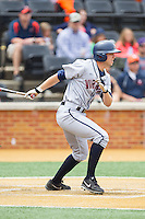 John La Prise (2) of the Virginia Cavaliers follows through on his swing against the Wake Forest Demon Deacons at Wake Forest Baseball Park on May 17, 2014 in Winston-Salem, North Carolina.  The Demon Deacons defeated the Cavaliers 4-3.  (Brian Westerholt/Four Seam Images)