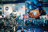 Space Center Houston. Main exhibit floor. Lunar lander at right, Space Shuttle at back wall between NASA emblem and American Flag. Houston Texas, Johnson Space Center.