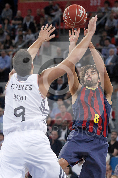 FC Barcelona's Victor Sada (r) and Real Madrid's Felipe Reyes during Supercopa ACB Final match.October 5,2013. (ALTERPHOTOS/Acero)