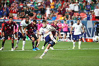 DENVER, CO - JUNE 6: Christian Pulisic #10 of the United States takes a PK and scores a goal during a game between Mexico and USMNT at Empower Field at Mile High on June 6, 2021 in Denver, Colorado.
