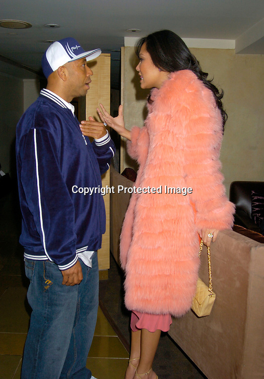 Russell and Kimora Lee Simmons..at The Phoenix House Benefit honoring Hip-Hop giant Russell Simmons on March 31, 2004 at the W Hotel in..New York City. Photo by Robin Platzer, Twin Images