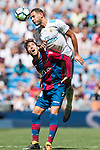 Theo Bernard Francois Hernandez Pi (top) of Real Madrid fights for the ball with Jose Gomez Campana of Levante UD (bottom) during the La Liga match between Real Madrid and Levante UD at the Estadio Santiago Bernabeu on 09 September 2017 in Madrid, Spain. Photo by Diego Gonzalez / Power Sport Images