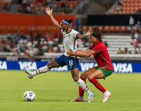 HOUSTON, TX - JUNE 10: Crystal Dunn #19 of the USWNT is fouled by Jessica Silva #10 of Portugal during a game between Portugal and USWNT at BBVA Stadium on June 10, 2021 in Houston, Texas.