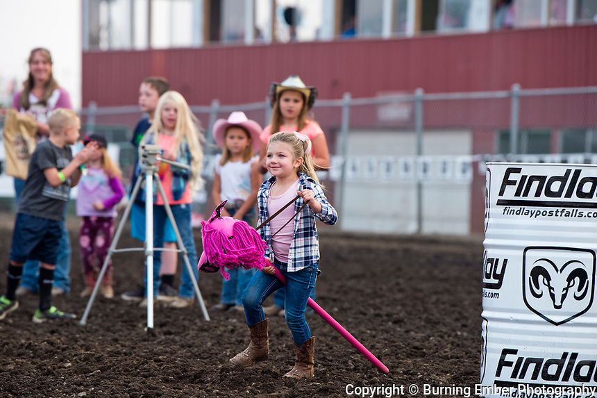 the kids tear it up in the stick horse race before the 1st perf at the Gem State Stampede August 24th, 2018 1st perf in Couer D'Alene ID.  Photo by Josh Homer/Burning Ember Photography.  Photo credit must be given on all uses.