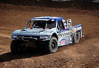 Mar. 18, 2011; Chandler, AZ, USA;  LOORRS pro 4 unlimited driver Travis Coyne during qualifying for round one at Firebird International Raceway. Mandatory Credit: Mark J. Rebilas-