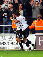 ATTENTION SPORTS PICTURE DESK<br /> Pictured: Federico Bessone and Ashleigh WIlliams of Swansea celebrating the second goal for their team.<br /> Re: Coca Cola Championship, Swansea City Football Club v Cardiff City FC at the Liberty Stadium, Swansea, south Wales. Saturday 07 November 2009