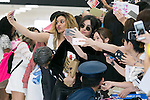 (L to R) Dina-Jane Hansen and Camila Cabello, members of the American five-piece girl group Fifth Harmony take pictures with fans upon their arrival at Narita International Airport on July 7, 2016, Chiba, Japan. Fifth Harmony are in Japan for the first time to promote their new song Work from Home. Fifth Harmony flew 25 hours from Sau Paulo to Japan after finishing their tour of South America. (Photo by Rodrigo Reyes Marin/AFLO)
