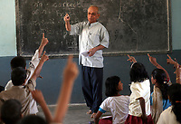 Girish Chandra teaches english to students at the Vimochana School in Malabad, India.  The school was the first residential school for the children of Devadasis and was founded in 1990 to break the cycle of the Devadasi system.  Because the belief is that all female children of Devadasis should themselves become Devadasis, the school was created to remove the children from the culture in which this practice took place and instead offer them an education.  All students receive free tuition, books, uniforms, food and medical care. Graduates have gone on to become teachers, nurses, engineers etc.