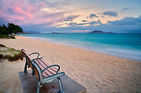 Bench with sunrise clouds and ocean. Kailua Beach Park, Oahu, Hawaii