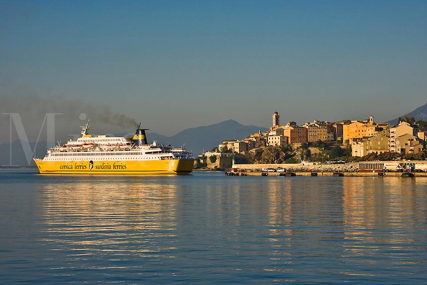 Corsica. Bastia. Citadel and Quartier Terra Nova and entrance to the Old Port. Car ferry arriving.  France.