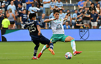 KANSAS CITY, KS - AUGUST 10: Ozzie Cisneros #25 of Sporting Kansas City and Santiago Colombatto #22 of Club Leon FC battle for the ball in midfield during a game between Club Leon FC and Sporting KC at Children's Mercy Park on August 10, 2021 in Kansas City, Kansas.