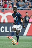 FOXBOROUGH, MA - SEPTEMBER 29: Wilfried Zahibo #23 of New England Revolution passes the ball during a game between New York City FC and New England Revolution at Gillettes Stadium on September 29, 2019 in Foxborough, Massachusetts.