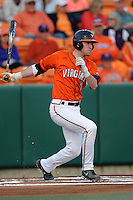Virginia Cavaliers shortstop Brandon Cogswell #7 swings at a pitch during a game against the Clemson Tigers at Doug Kingsmore Stadium on March 15, 2013 in Clemson, South Carolina. The Cavaliers won 6-5.(Tony Farlow/Four Seam Images).