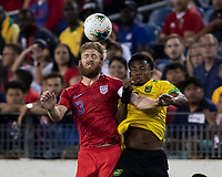 NASHVILLE, TN - JULY 3: Tim Ream #13 and Elvis Powell #5 vie for a header during a game between Jamaica and USMNT at Nissan Stadium on July 3, 2019 in Nashville, Tennessee.