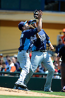 Tampa Bay Rays pitcher Jeremy Hellickson #58 collides with first baseman James Loney while catching a pop up during a Spring Training game against the Detroit Tigers at Joker Marchant Stadium on March 29, 2013 in Lakeland, Florida.  (Mike Janes/Four Seam Images)
