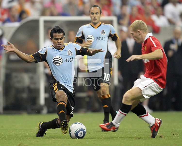 David Ferreira #20 of the MLS All-Stars during the 2010 MLS All-Star match against Manchester United is tackled by Paul Scholes #18 at Reliant Stadium, on July 28 2010, in Houston, Texas. Manchester United won 5-2.