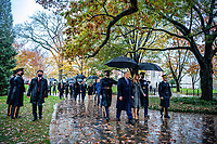 President Donald J. Trump (center), First Lady Melania Trump (center right), Vice President Mike Pence (back left), and Second Lady Karen Pence (back right) walk with U.S. Army Maj. Gen. Omar Jones IV (right), commanding general, U.S. Army Military District of Washington near the Memorial Amphitheater at Arlington National Cemetery, Arlington, Virginia, November 11, 2020. President Trump laid a wreath just prior to this photo at the Tomb of the Unknown Soldier in observance of Veterans Day. (U.S. Army photo by Elizabeth Fraser / Arlington National Cemetery / released)