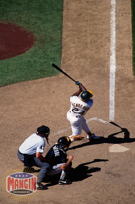 OAKLAND, CA - Rickey Henderson of the Oakland Athletics bats during a game against the Chicago White Sox at the Oakland Coliseum in Oakland, California on August 10, 1994. (Photo by Brad Mangin)