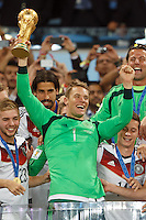 Goalkeeper Manuel Neuer of Germany lifts the World Cup trophy after winning the 2014 final
