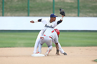 Erick Mejia (29) of the Everett AquaSox shows the ball to the umpire after putting the tag on Darius Day (1) of the Spokane Indians at second base during a game at Everett Memorial Stadium on July 24, 2015 in Everett, Washington. Everett defeated Spokane, 8-6. (Larry Goren/Four Seam Images)