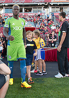 August 10, 2013: Seattle Sounders FC forward Eddie Johnson #7 walks onto the pitch before the opening ceremonies  in an MLS regular season game between the Seattle Sounders and Toronto FC at BMO Field in Toronto, Ontario Canada.<br /> Seattle Sounders FC won 2-1.