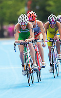 04 AUG 2012 - LONDON, GBR - Aileen Morrison (IRL) of Ireland (left)  leads Paula Findlay (CAN) of Canada (right) on the bike during the women's London 2012 Olympic Games Triathlon in Hyde Park, London, Great Britain (PHOTO (C) 2012 NIGEL FARROW)