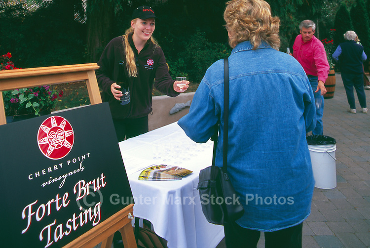 Woman wine tasting at Cherry Point Vineyards, at the Cowichan Valley Wine & Culinary Festival, on Vancouver Island, British Columbia, Canada