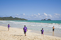 Children playing football during a charity surfing event in Waimanalo