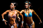 Ho On Nor Anna Christianne flexes muscles for judges on stage during the Hong Kong Bodybuilding Championship on 29 June 2014 at the Queen Elizabeth Stadium Arena in Hong Kong, China. Photo by Aitor Alcalde /  Power Sport Images