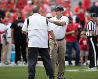 ATHENS, GA - OCTOBER 2: Georgia coach Kirby Smart speaks to Arkansas coach Sam Pittman prior to a game between Arkansas Razorbacks and Georgia Bulldogs at Sanford Stadium on October 2, 2021 in Athens, Georgia.