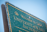 A UAA Parking Services welcome sign covered in frost on a chilly morning.