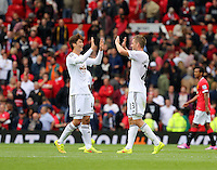 Pictured L-R: Swansea co-scorers Ki Sung Yueng and Gylfi Sigurdsson congratulate each other after the final whistle. Saturday 16 August 2014<br />