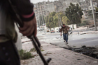 A Syrian civilian gets shot at his stomach as he tries to scape from the line of fire after he was already targeted at his back by one Syrian army sniper while was walking at the front line in Bustan Al-Bashar, northeast of Aleppo City.
