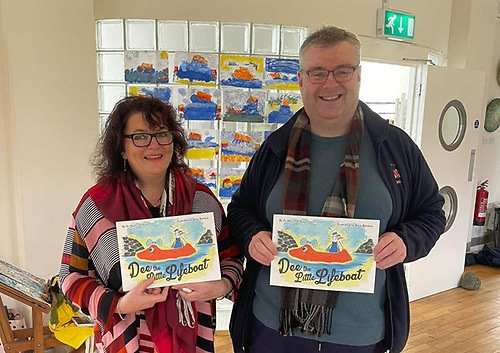 Alice Rohdich and Martin O'Kane with their book Dee the Little Lifeboat | Credit: RNLI/Judy Nelson