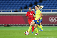 YOKOHAMA, JAPAN - AUGUST 6: Amanda Ilestedt #13 of Sweden passes the ball during a game between Canada and Sweden at International Stadium Yokohama on August 6, 2021 in Yokohama, Japan.