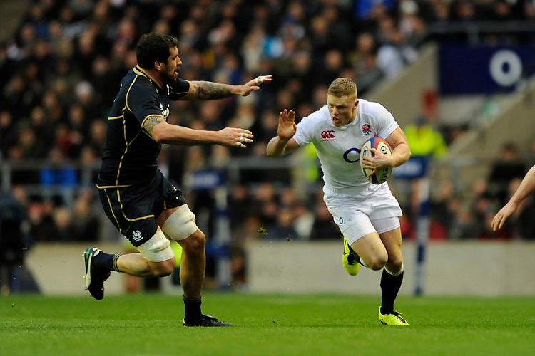 Chris Ashton of England goes around Jim Hamilton of Scotland during the RBS 6 Nations match between England and Scotland at Twickenham on Saturday 02 February 2013 (Photo by Rob Munro)