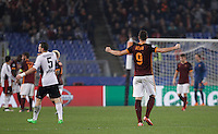 Calcio, Champions League, Gruppo E: Roma vs Bayer Leverkusen. Roma, stadio Olimpico, 4 novembre 2015.<br /> Roma's Edin Dzeko, right, celebrates as Bayer Leverkusen's Kyriakos Papadopoulos, left, reacts at the end of a Champions League, Group E football match between Roma and Bayer Leverkusen, at Rome's Olympic stadium, 4 November 2015.<br /> UPDATE IMAGES PRESS/Isabella Bonotto
