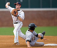 Keith Werman #2 of the Virginia Cavaliers turns a double play against the VCU Rams at the Charlottesville Regional of the 2010 College World Series at Davenport Field on June 4, 2010, in Charlottesville, Virginia.  The Cavaliers defeated the Rams 14-5.  Photo by Brian Westerholt / Four Seam Images