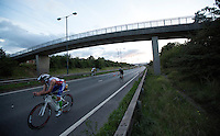16 AUG 2014 - DARTFORD, GBR - Matthew Holt from the Metropolitan Police Triathlon Club races along a closed lane of Bob Dunn Way during the 2014 Midnight Wo/Man triathlon in Dartford, Great Britain (PHOTO COPYRIGHT © 2014 NIGEL FARROW, ALL RIGHTS RESERVED)