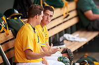 AZL Athletics Gold catcher Cesarre Astorri (22) talks to Nick Hundley (7) during an Arizona League game against the AZL Giants Black on July 12, 2019 at Hohokam Stadium in Mesa, Arizona. The AZL Giants Black defeated the AZL Athletics Gold 9-7. (Zachary Lucy/Four Seam Images)
