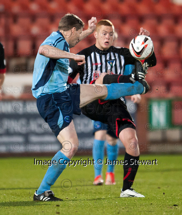 Forfar's Darren Dods and Pars' Robert Thomson challenge for the ball.