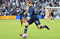 KANSAS CITY, KS - MAY 16: Wilson Harris #96 Sporting KC with the ball during a game between Vancouver Whitecaps and Sporting Kansas City at Children's Mercy Park on May 16, 2021 in Kansas City, Kansas.