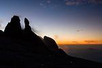 "Silhouette of the ""Donkeys Ears"" at sunrise, towards the summit of Mt Kinabalu, Kinabalu Park, Sabah, Borneo."