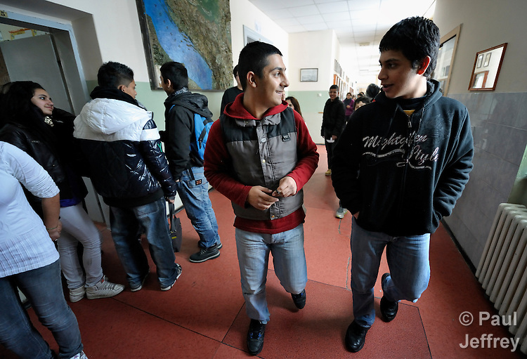 Bajram Kruezi (center) walks in the hallway with other students at the Branko Pesic School, an educational center for Roma children and families in Belgrade, Serbia, which is supported by Church World Service. Kruezi's family came to Belgrade as refugees from Kosovo, and like many Roma can't afford regular school fees. Many Roma also lack legal status in Serbia, and thus have difficulty obtaining formal employment and accessing government services.