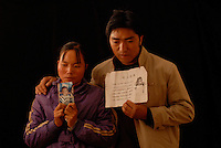 "Mr and Mrs Ma holds a picture of her son Ma Purei, 3 and half years old,  who was stolen  March 22nd  2004.  The message reads, ""Papa and Mama are hoping that you will come home soon.""  Mrs Ha and Mrs Ma is one of thousands of migrant mothers whose children have been stolen and sold to rich families desperate for a boy. Families are limited to a single child under the China's ruthless One Child Policy.<br /> ©sinopix"